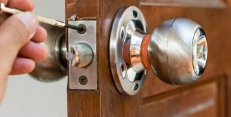 closeup of locksmith on old wood door , repair